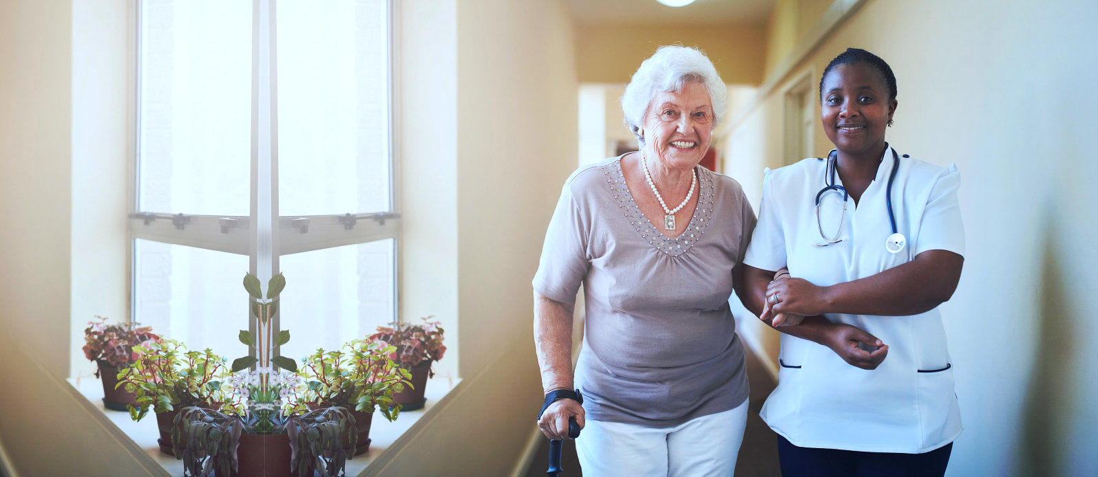 caregiver and senior woman walking