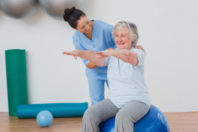 caregiver conducting physical theraphy indoor