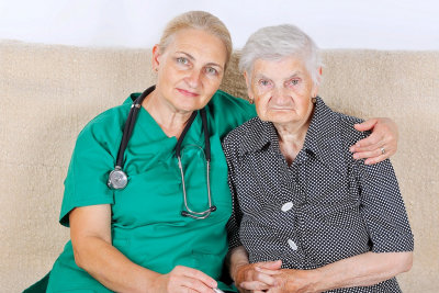 senior nurse hugging senior woman